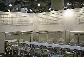 Generic booth with hardwall by Manny Stone Decorators